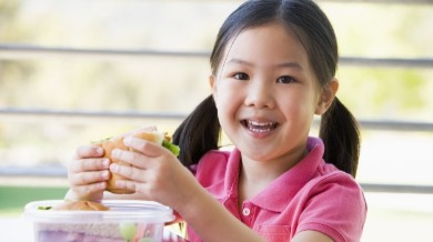 child eating a sandwich | Island Real Estate