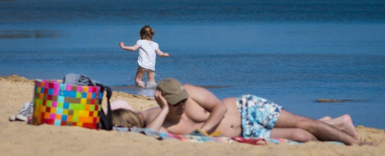 Dozing on the Beach with a Toddler | Island Real Estate