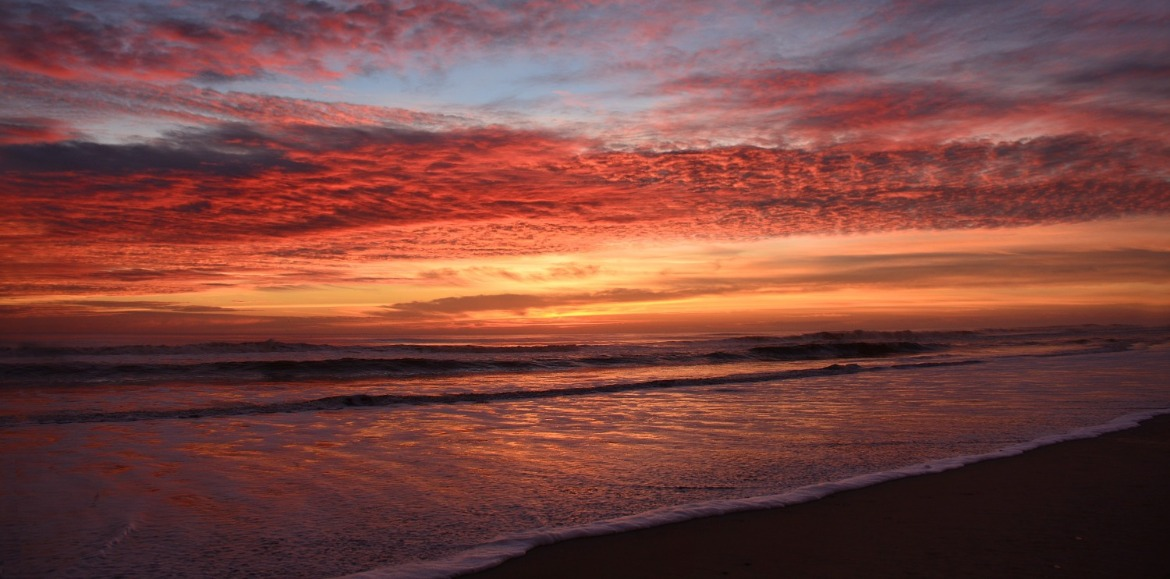 beautiful sunset over the beach | Island Real Estate