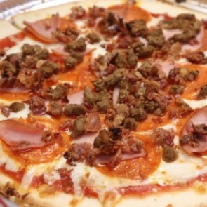 meat pizza from Michaelangelos | Island Real Estate
