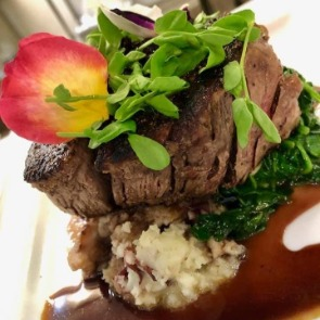 steak filet at Beauchaine's 211 | Island Real Estate