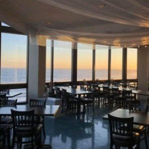 ocean view dining at Ocean's Edge | Island Real Estate