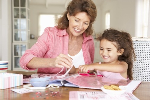 woman and child assembling scrapbook | Island Real Estate