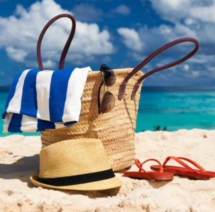 beach bag sitting on the beach | Island Real Estate