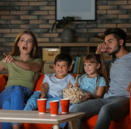 family watching movie together | Island Real Estate