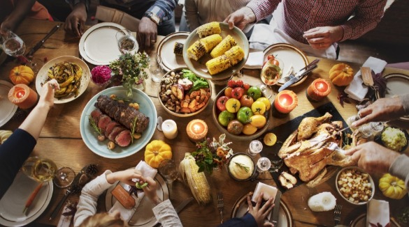 family enjoying thanksgiving dinner | Island Real Estate