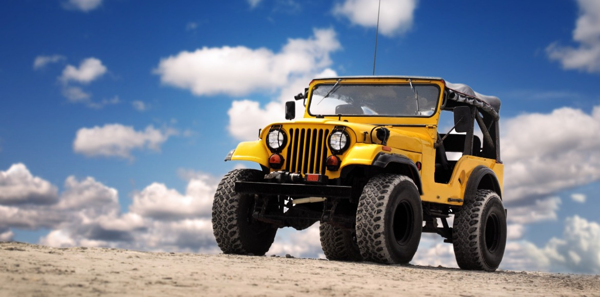 yellow Jeep on the beach | Island Real Estate