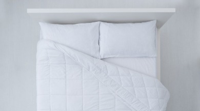 white simple bedding | Island Real Estate