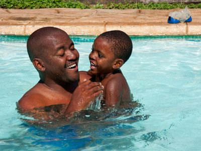 dad and son in pool